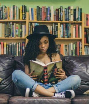 girl reading seven shooter unsplash