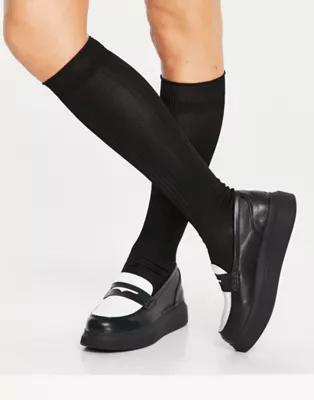 Mocassins en similicuir noir et blanc, Koi Footwear, 48,99€.