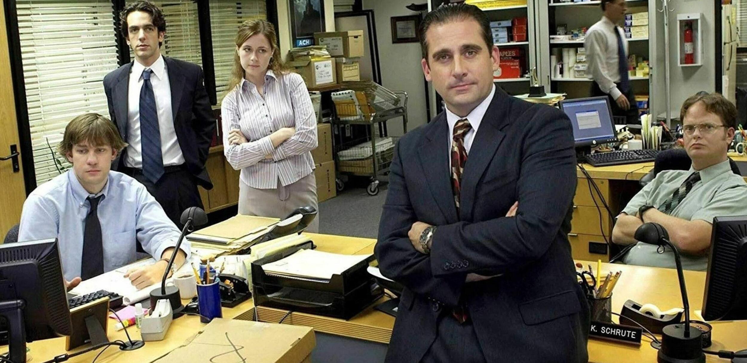 Un groupe de collègues à l'air blasé, dans la série The Office.